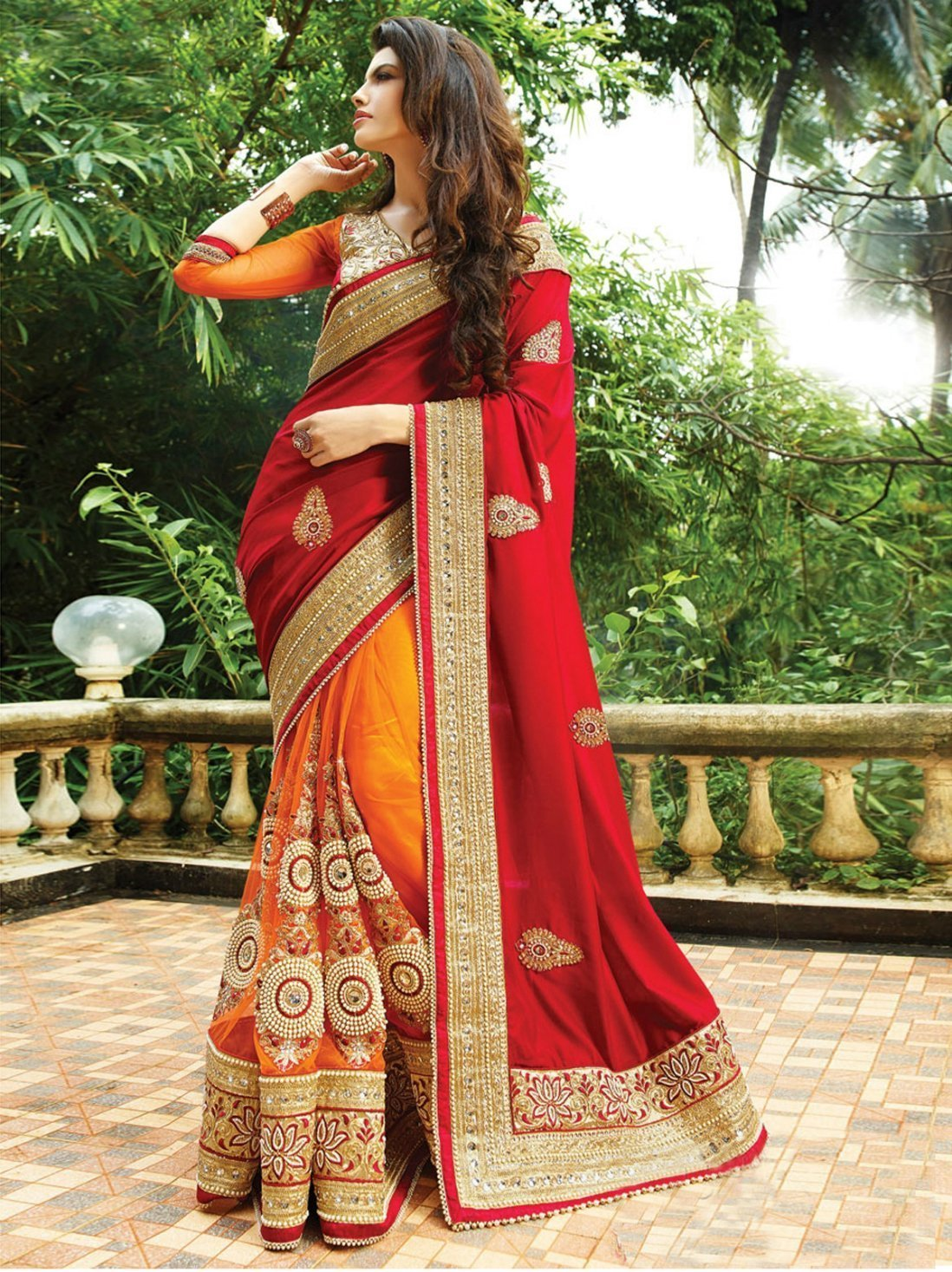 Red and orange color silk with georgette material saree